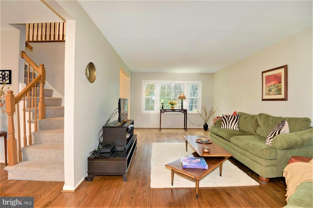 large windows over looking a private backyard - 2305 ROSEDOWN DR, RESTON