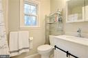 updated hall bath - 2305 ROSEDOWN DR, RESTON
