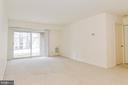 Light-filled  living room access to private patio! - 5938 COVE LANDING RD #102A, BURKE