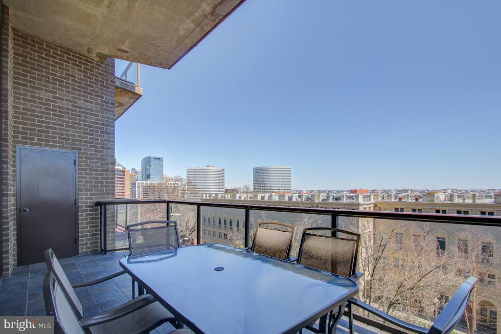 Balcony accommodates table for 4.. - 1401 N OAK ST N #305, ARLINGTON