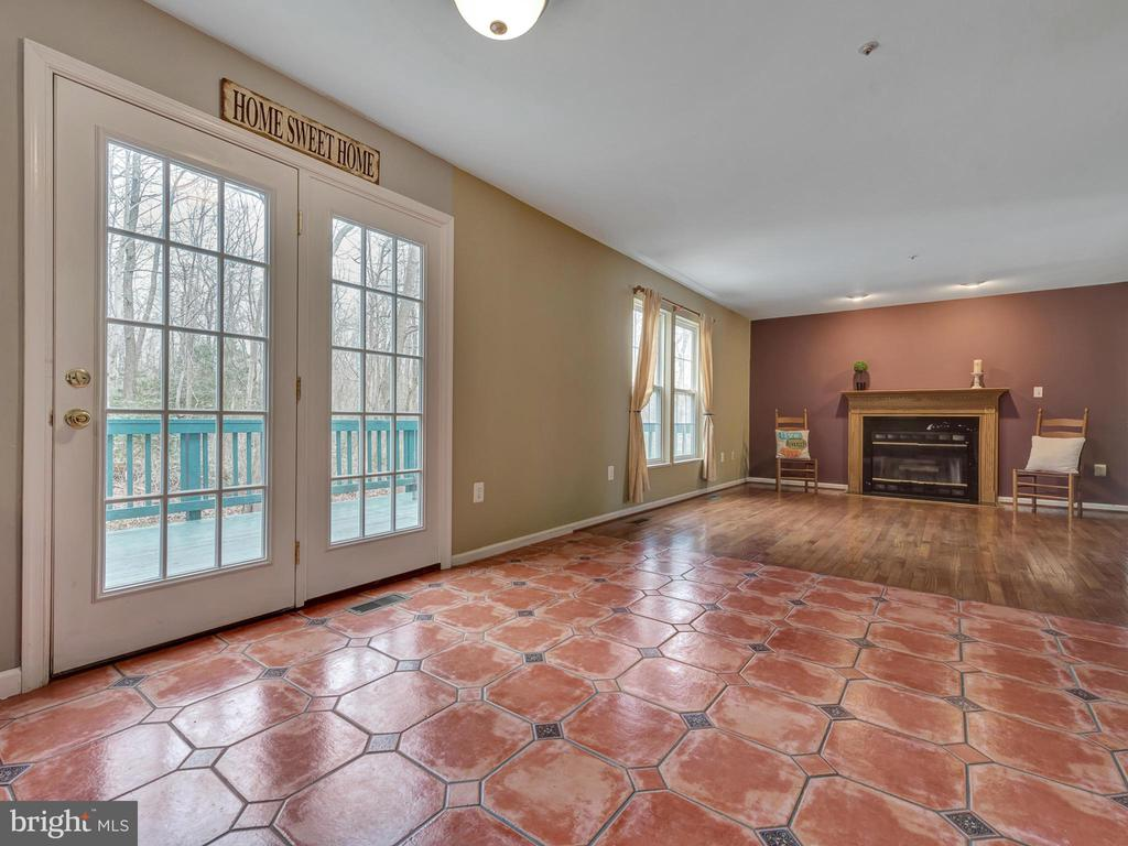 French doors lead to deck... great LR w/FP - 6012 CREST PARK DR, RIVERDALE