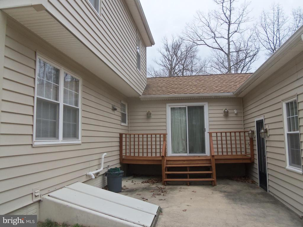 Rear view with deck off extended family room. - 6411 JUANITA CT, SUITLAND