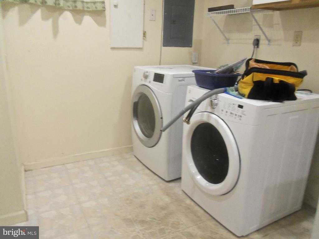 Laundry room on lower level. - 6411 JUANITA CT, SUITLAND