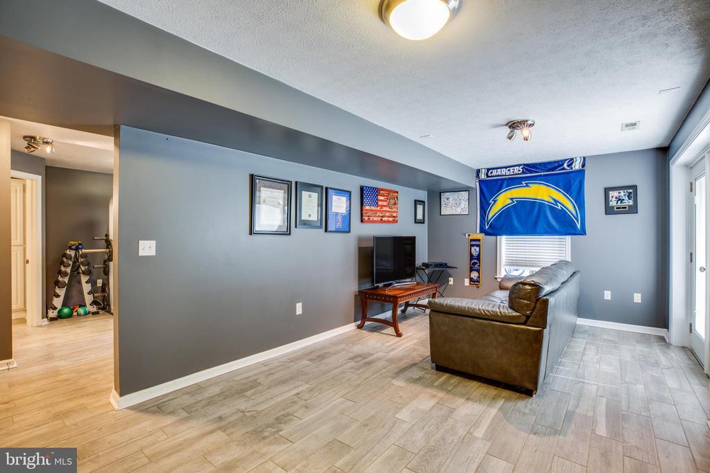 Rec room off of basement bedroom, tile floor. - 40 NORTHAMPTON BLVD, STAFFORD