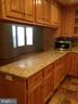 Kitchen granite counters & view of family room. - 6411 JUANITA CT, SUITLAND