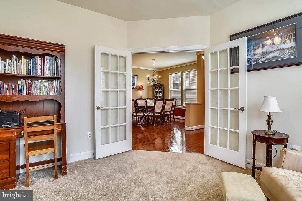 LIBRARY FRENCH DOORS OPEN TO FOYER - 5709 SPRIGGS MEADOW DR, WOODBRIDGE