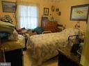 Bedroom 2 with vinyl flooring - 535 MONTICELLO CIR, LOCUST GROVE