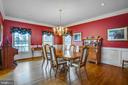 Separate dining room with  gleaming wood floors - 7411 SNOW HILL DR, SPOTSYLVANIA