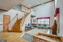 Foyer into living room with cathedral ceiling - 7411 SNOW HILL DR, SPOTSYLVANIA