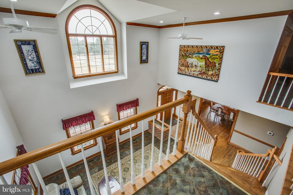 High ceiling overlooking the living area. - 7411 SNOW HILL DR, SPOTSYLVANIA