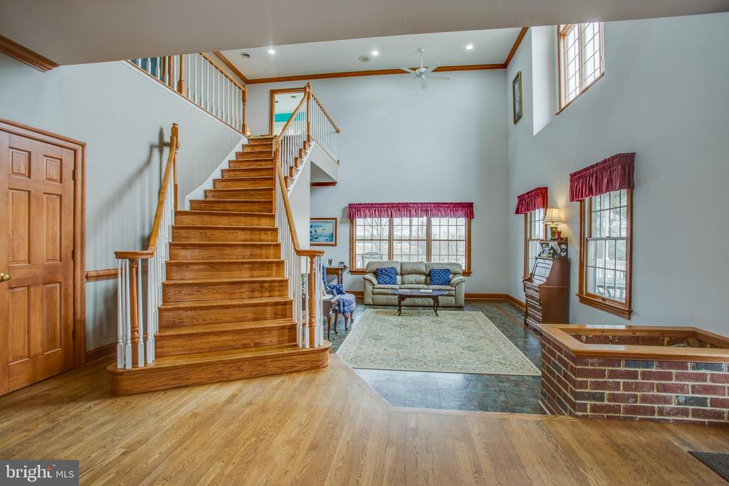 Grand stairway to upstairs. Lots of natural light. - 7411 SNOW HILL DR, SPOTSYLVANIA