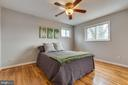 Bedroom 1 with updated ceiling fan - 10321 WOOD RD, FAIRFAX