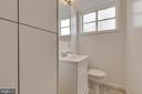 Lower level powder room off family room - 10321 WOOD RD, FAIRFAX