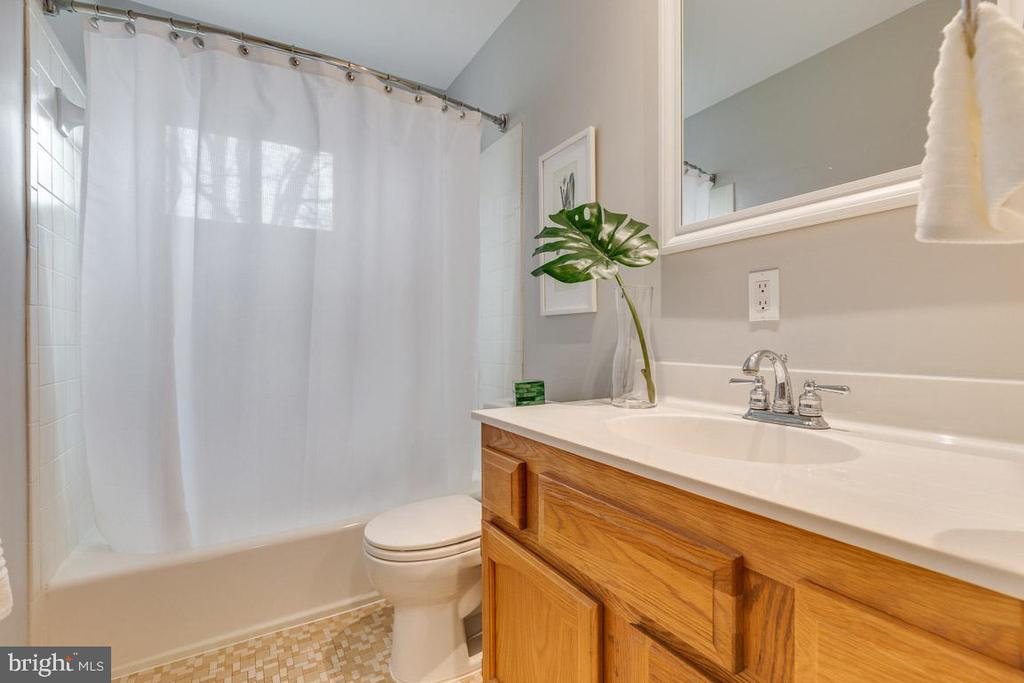 Level 2 hall bathroom with updated fixtures - 10321 WOOD RD, FAIRFAX