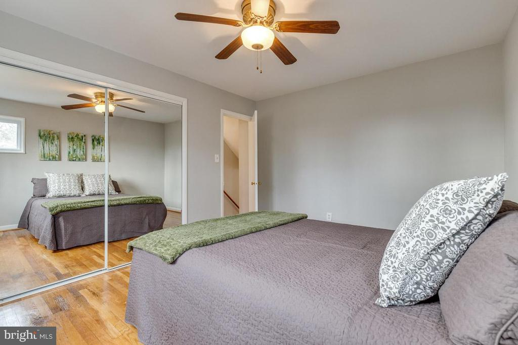 Bedroom 1 with refinished hardwood floors - 10321 WOOD RD, FAIRFAX