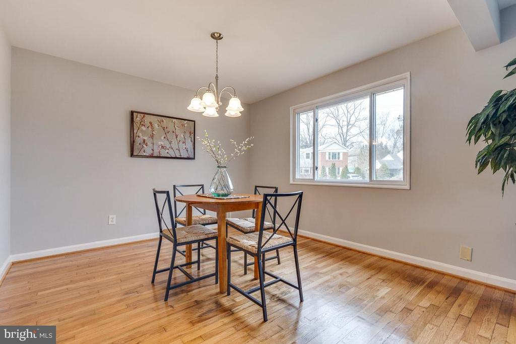 Updated dining room with new chandelier - 10321 WOOD RD, FAIRFAX