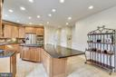 Expansive Kitchen Island with Downdraft Cooktop. - 3446 VALEWOOD DR, OAKTON