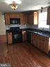 Upgraded kitchen with granite counter tops! - 10273 WINDGATE CT, MANASSAS
