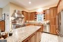 Large kitchen island, lots of cabinets - 3013 N DICKERSON ST, ARLINGTON