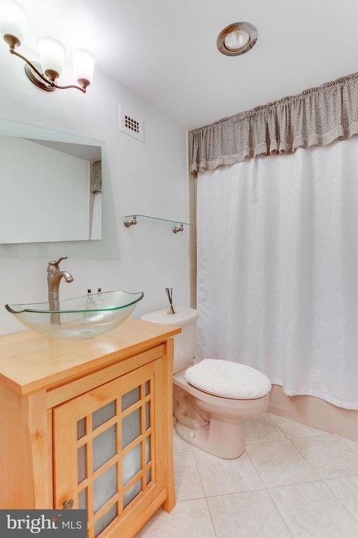 Updated hall bath - 1200 N NASH ST #551, ARLINGTON