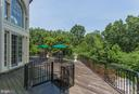 Large patio with spiral staircase to pool - 7984 GEORGETOWN PIKE, MCLEAN