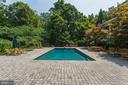 Cobblestone pool deck with room for entertaining - 7984 GEORGETOWN PIKE, MCLEAN