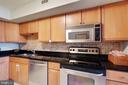 Kitchen - Upgraded Granite Counters - 2230 GEORGE C MARSHALL DR #327, FALLS CHURCH