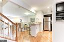 Kitchen island features granite and seating for 4 - 1460 PARK GARDEN LN, RESTON