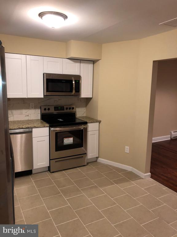 Kitchen View  w/ nice white cabinets - 5008 BRAYMER AVE, SUITLAND