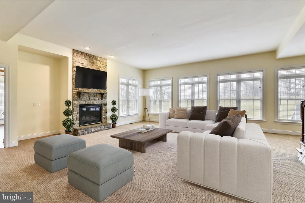 Family room has gas fireplace and wall of windows. - 16600 FERRIERS CT, LEESBURG