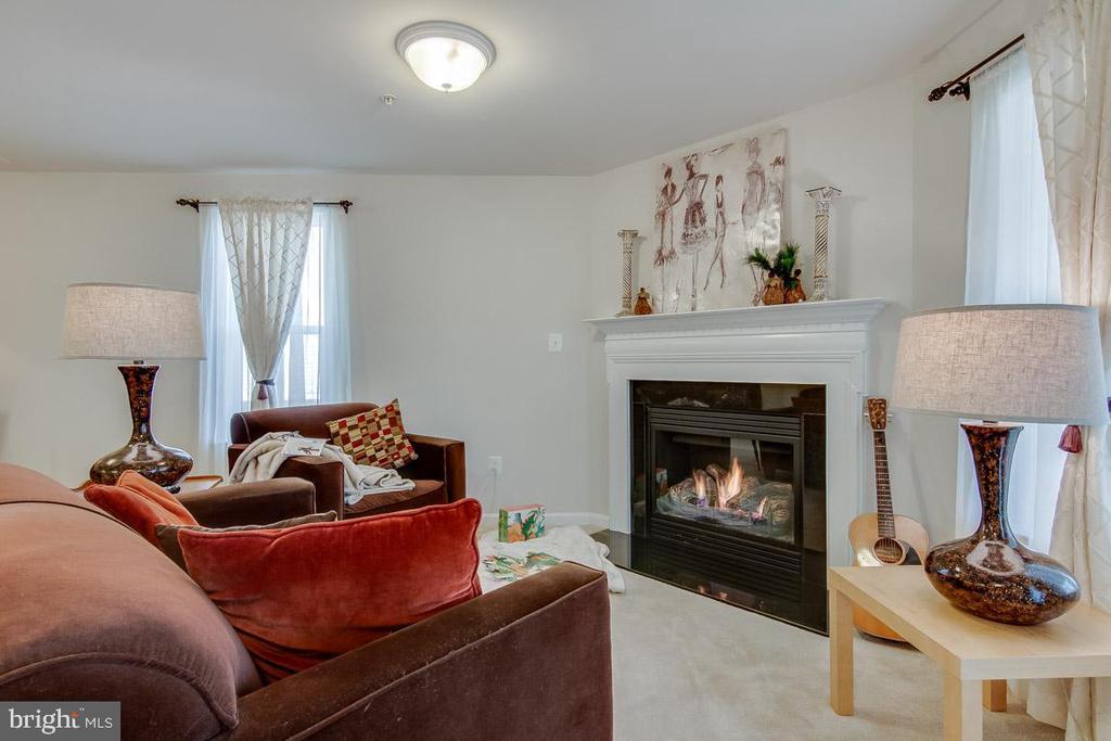 Cozy up by the fireplace - 601 FOX RIVER HILLS WAY, GLEN BURNIE