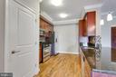 Open kitchen with SS appliances & granite counters - 6301 EDSALL RD #124, ALEXANDRIA