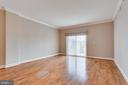 Living room with sliding door to private balcony - 6301 EDSALL RD #124, ALEXANDRIA