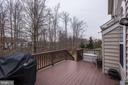 Deck with stairs down to backyard. - 8830 WARM GRANITE DR DR #51, COLUMBIA