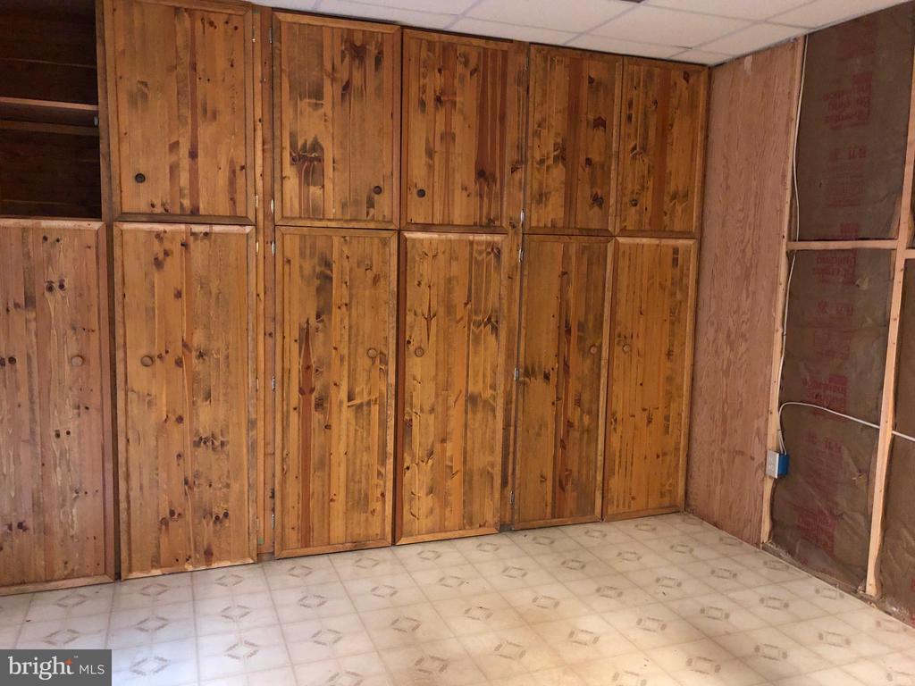 Hideaway storage in basement - 8809 MILLWOOD DR, SPOTSYLVANIA