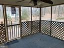 Screened porch off dining area with wooded view - 8809 MILLWOOD DR, SPOTSYLVANIA