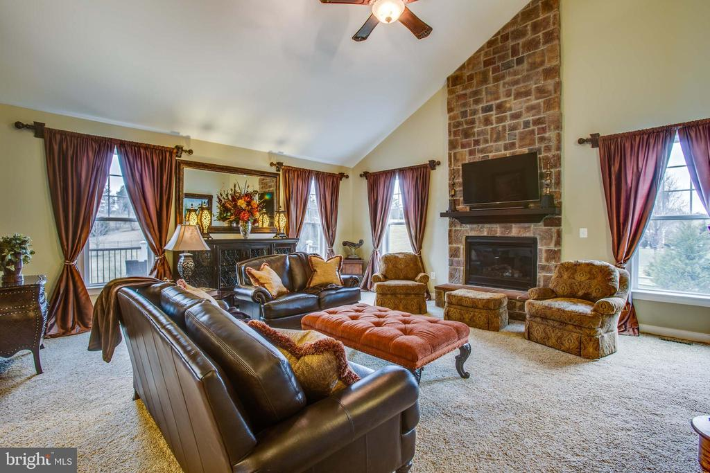 Floor to ceiling stone gas fireplace - 90 LUPINE DR, STAFFORD