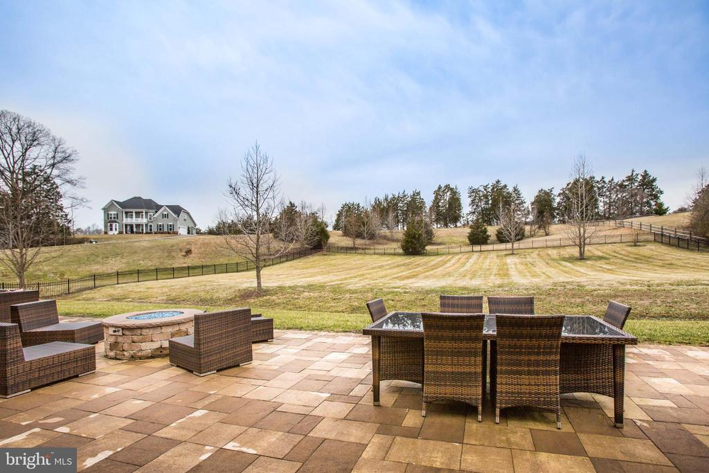 Paver patio overlooks the backyard - 90 LUPINE DR, STAFFORD