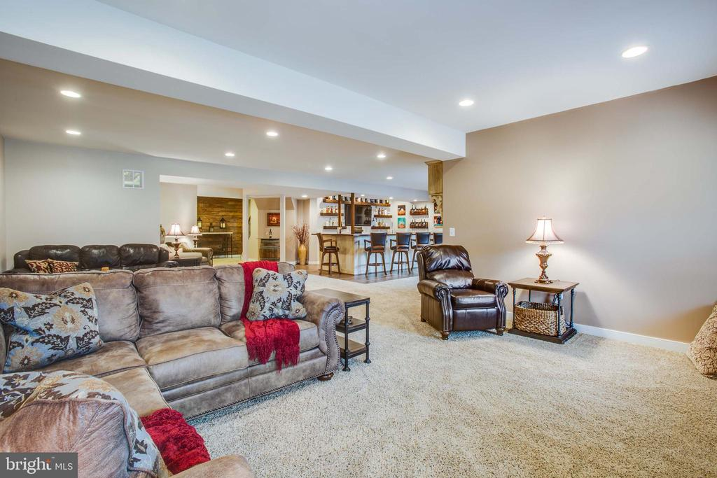 TV area  in the basement - 90 LUPINE DR, STAFFORD