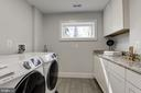 Separate Laundry Rm with Cabinets, Granite & Sink. - 10526 HUNTERS VALLEY RD, VIENNA