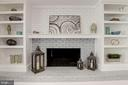Brick Fireplace with Custom Shelving - 10526 HUNTERS VALLEY RD, VIENNA