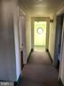 Hall leading to 2 bd/2ba floors wood under w/w - 1919 CASTLEMAN RD, BERRYVILLE