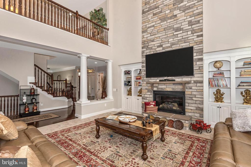 Family room~with authentic stone wall Fireplace! - 42617 NICKELINE PL, CHANTILLY