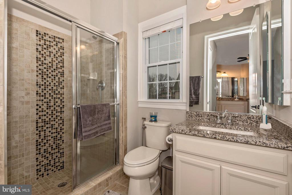 In-law suite Bathroom with tiled shower & bench! - 42617 NICKELINE PL, CHANTILLY