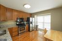 Kitchen with granite counters and eat in space - 46675 ASHMERE SQ, STERLING