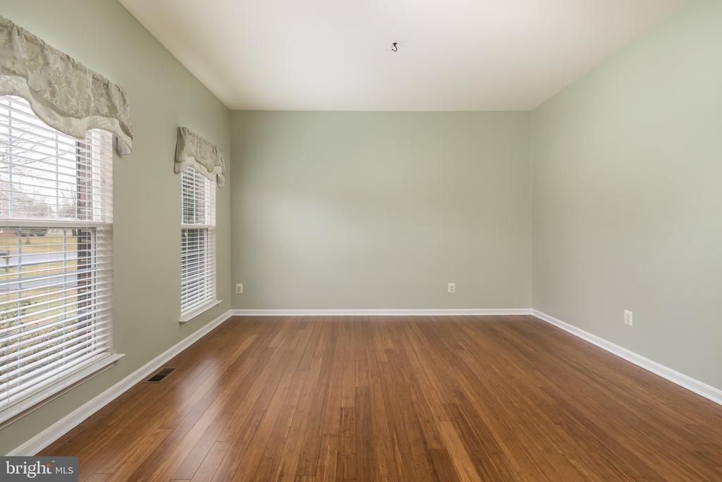 Beautiful bamboo flooring throughout first floor - 11108 STAINSBY CT, BRISTOW