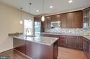 Pendant lights and double wall ovens in kitchen - 6255 CASDIN DR, ALEXANDRIA
