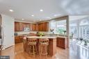 Gourmet kitchen w/granite & stainless appliances - 1075 CEDAR CHASE CT, HERNDON
