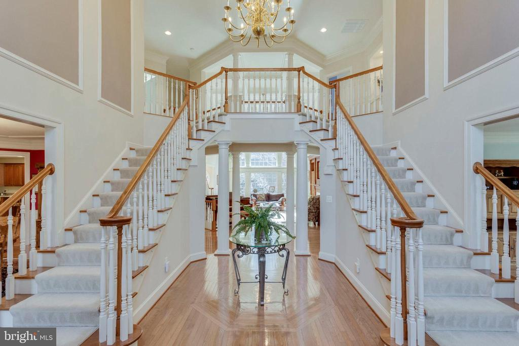Grand foyer with dual staircases! - 1075 CEDAR CHASE CT, HERNDON