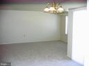 View from dining area towards living room - 125 S CLUBHOUSE DR SW #8, LEESBURG